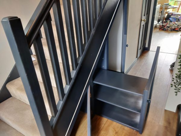 under-stairs storage with slideout shoe rack